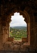 Green hills seen through window of ruined ancient castle