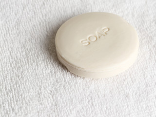 Piece of soap on a white towel