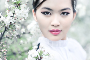 Young woman with cherry flowers