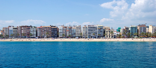 Panoramic cityscape of Lloret de Mar from sea.