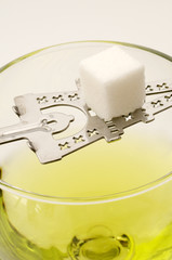 Absinthe with Stirring Spoon and Sugar Cube