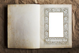 vintage book with art nouveau picture frame, free copy space poster