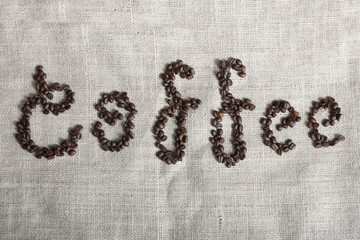 Coffee spelled by coffee beans