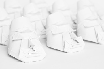 A group of origami faces on a white background