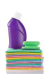 Plastic detergent bottle and sponges