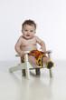 little boy in chair on white