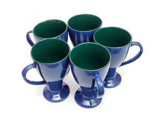 Circle of five blue long-stemmed coffee cups isolated