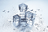 Melting ice cubes on a metal tabletop poster