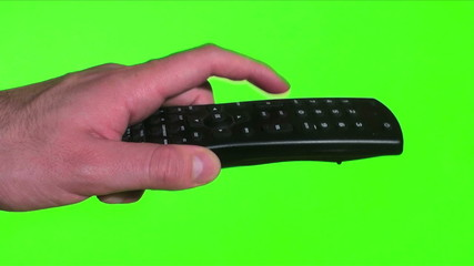 TV remote against green screen side view - HD