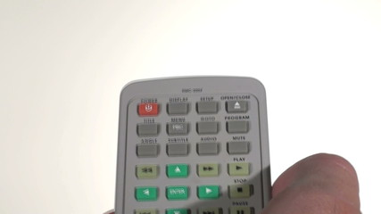 Male thumb pushes buttons on television remote - HD