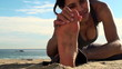 Young woman performing yoga stretches on the beach - HD