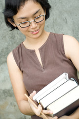 smart asian young woman with books