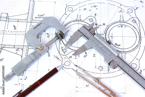Micrometer, Caliper, Mechanical Pencil and Compass on Blueprint