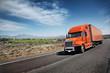 Orange American truck on freeway