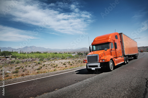 Orange American truck on freeway
