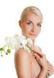Fototapety Beautiful young woman with white orchid