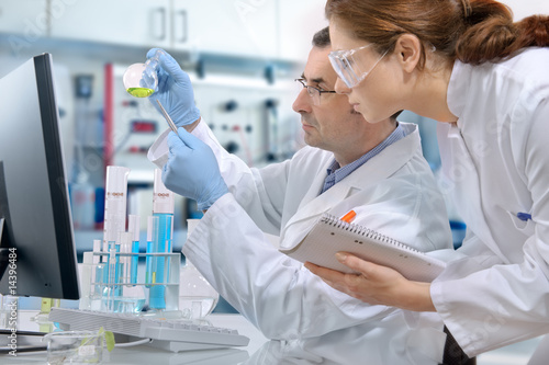 scientists working at the laboratory - 14396484
