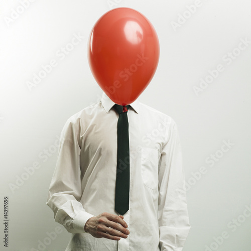 Portrait of office manager with head - balloon
