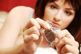 Woman opening condom