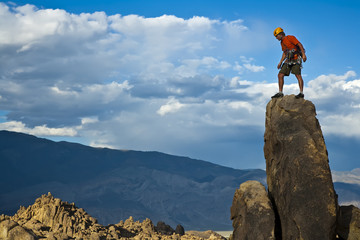 Rock climber nearing the summit.