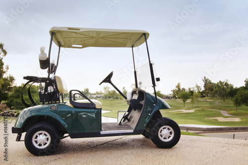 Golf cart ready for golfers on first hole