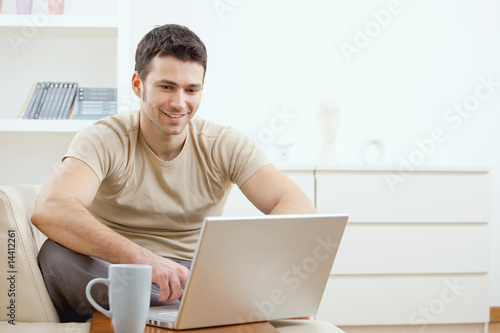 Happy man using computer - 14412261