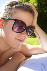 Woman reading papers outside