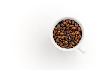 Beans of Coffee in a Cup