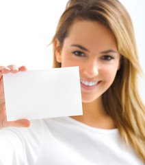 young blond portrait girl with withe card