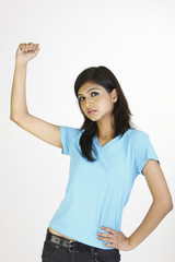 Happy girl in blue T-shirt with success  pose
