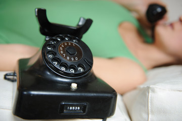 vintag telephone and girl calling blurred in the background