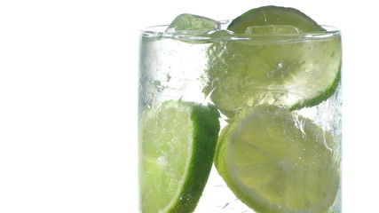 Ice-cold soda with lemon and lime slices seamless loop - HD