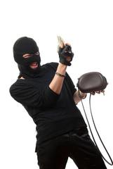 Happy robber takes money from stolen handbag.