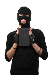Repentant robber with the Bible