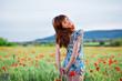 Smiling girl in poppy field