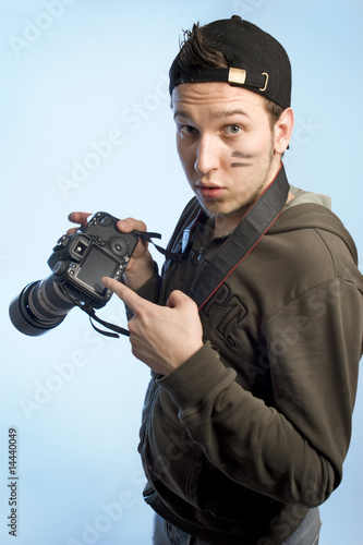 Young man with a photo camera