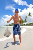 Teen with sting-ray on the beach poster