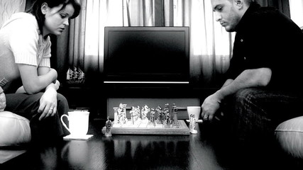 Couple playing chess,time lapse