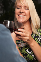 Blonde Socializing with Wine Glass