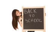 Back to school Asian female student by blackboard