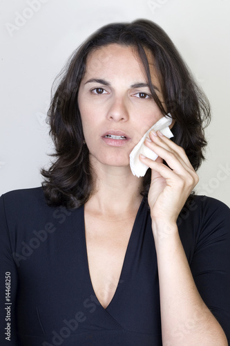 Young woman having toothache isolated on white background