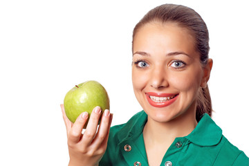 Young  woman in green shirt with green apple in hands