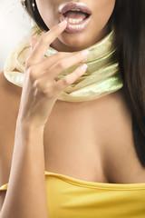 Beautiful young beauty touching lips