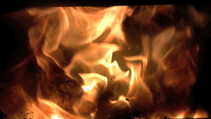 flames inside woodburning stove with zoom to flames