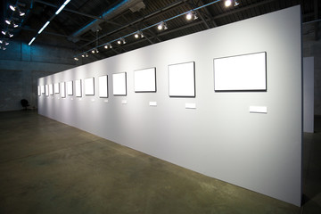 white wall with many empty frames