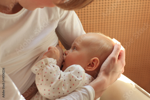 poster of mother breastfeeding baby