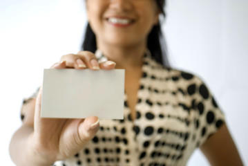 Business female holding name card