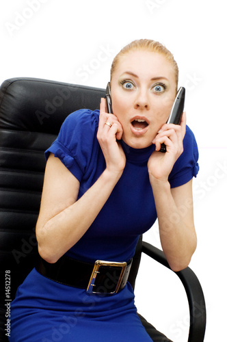 Busy and shocked businesswoman with two phones