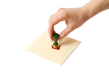 woman sets the seal an envelope