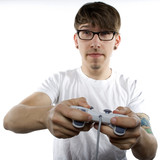 Young man with tattoos playing video games poster